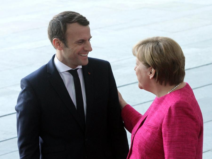 Merkel und Macron unterzeichnen